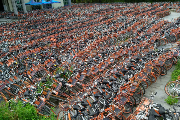 Bicycles of Chinese bike-sharing service Mobike are lined up in Shenzhen city, south China's Guangdong province, on July 13, 2017. [Photo: Imagine China]