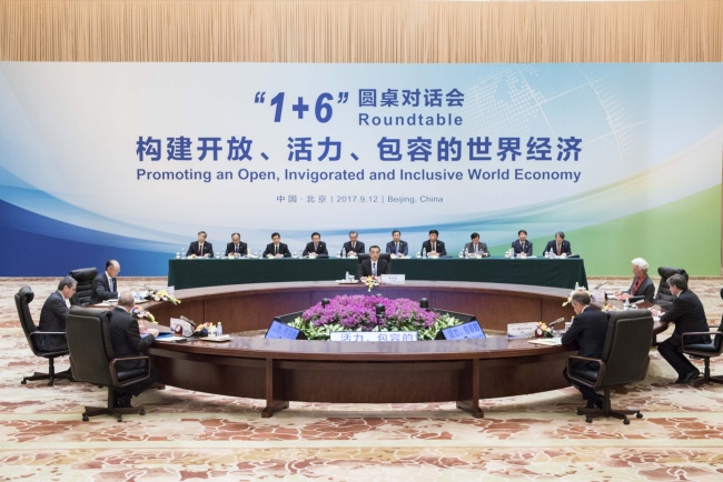 Chinese Premier Li Keqiang holds the '1+6' round table dialogue with World Bank Group President Jim Yong Kim, IMF (International Monetary Fund) Managing Director Christine Lagarde, WTO (World Trade Organization) Director-General Roberto Azevedo, ILO (International Labor Organization) Director-General Guy Ryder, OECD (Organization for Economic Cooperation and Development) Secretary-General Angel Gurria and FSB (Financial Stability Board) Chairman Mark Carney in Beijing on Tuesday, September 12, 2017. The dialogue is conducted with the theme 'promoting an open, invigorated and inclusive world economy'. [Photo: gov.cn]