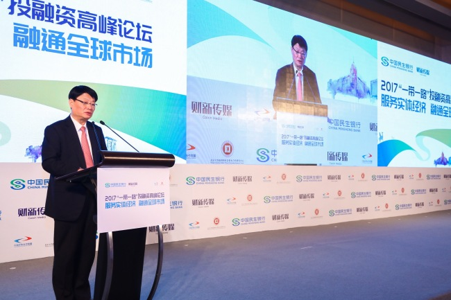 Hong Qi, chairman of China Minsheng Bank, speaks during Belt and Road Investing and Financing Forum in Beijing, on Nov. 30, 2017. [Photo provided to China Plus]