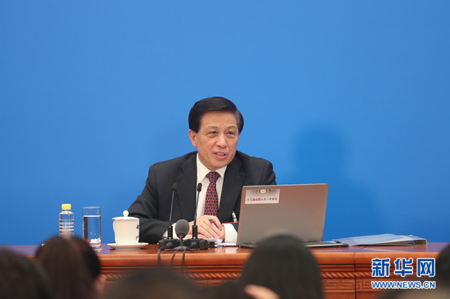 Zhang Yesui, spokesperson of the first session of the 13th National People's Congress (NPC) answers questions from the press in Beijing on March 4, 2018. [Photo: Xinhua]