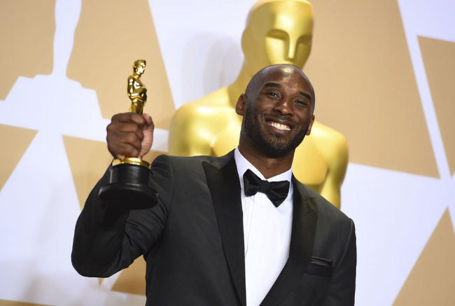 "Kobe Bryant, winner of the award for best animated short for ""Dear Basketball"", poses in the press room at the Oscars on Sunday, March 4, 2018, at the Dolby Theatre in Los Angeles. [Photo by Jordan Strauss/Invision/AP]"