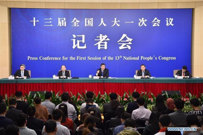 Head of the National Development and Reform Commission (NDRC) He Lifeng (C), deputy heads of the NDRC Zhang Yong (R) and Ning Jizhe, take questions during a press conference on innovation and improvement of macro-economic control and promotion of high quality development for the first session of the 13th National People's Congress in Beijing, capital of China, March 6, 2018.[Photo:Xinhua]