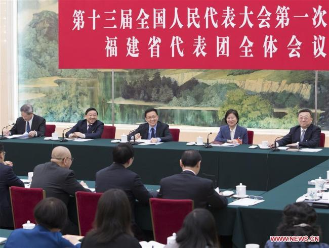Han Zheng, a member of the Standing Committee of the Political Bureau of the Communist Party of China (CPC) Central Committee, joins a panel discussion with deputies from Fujian Province at the first session of the 13th National People's Congress in Beijing, capital of China, March 8, 2018. [Photo: Xinhua/Wang Ye]