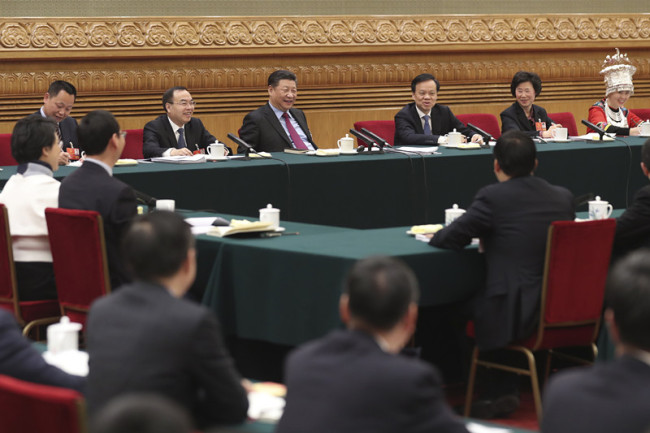Chinese President Xi Jinping, also general secretary of the Communist Party of China (CPC) Central Committee and chairman of the Central Military Commission, joins a panel discussion with deputies from Chongqing Municipality at the first session of the 13th National People's Congress in Beijing on Saturday, March 10, 2018. [Photo: China News Service]