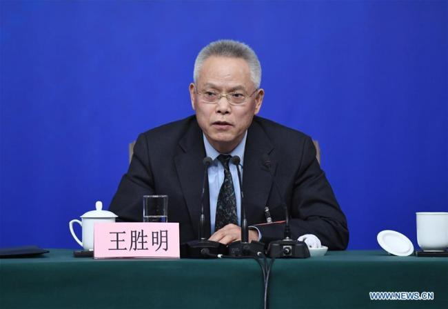 Wang Shengming, vice chairman of Internal and Judicial Affairs Committee of the 12th National People's Congress (NPC), answers questions at a press conference on legislation work of the NPC on the sidelines of the first session of the 13th NPC in Beijing, March 12, 2018.[Photo: Xinhua]