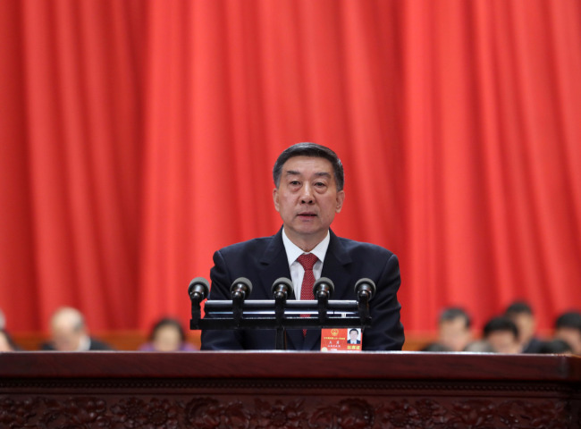 Chinese State Councilor Wang Yong delivers an institutional restructuring plan of the State Council at the fourth plenary meeting of the first session of the 13th National People's Congress (NPC) at the Great Hall of the People in Beijing, March 13, 2018.[Photo: Xinhua]