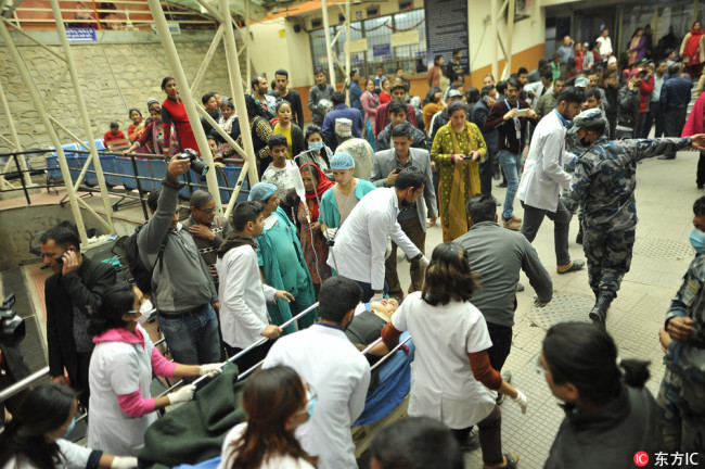 Nepalese doctors pull the stretcher of a survivor of US-Bangla plane crash for further treatment at Kathmandu Medical College Hospital at Kathmandu, Nepal on Monday, March 12, 2018. [Photo: IC]