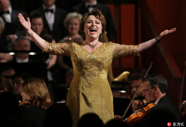 Soprano Rebecca Evans sings as the Prince of Wales attends a 70th anniversary gala concert for Welsh National Opera conducted by Carlo Rizzi at the Buckingham Palace, London.