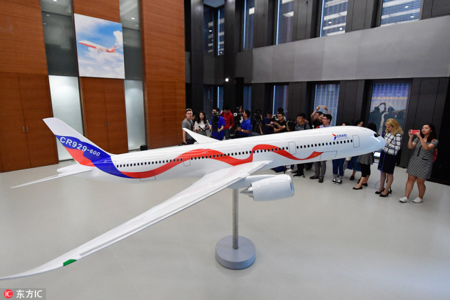 A model of the CR929 wide-body long-range passenger aircraft to be developed by China and Russia is on display at the headquarters of the Commercial Aircraft Corporation of China (COMAC) in Shanghai on September 29, 2017. [Photo: IC]