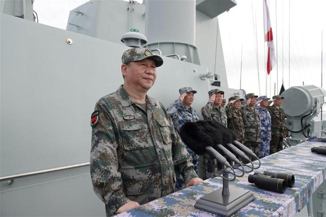 Chinese President Xi Jinping, also general secretary of the Communist Party of China Central Committee and chairman of the Central Military Commission, reviews the Chinese People's Liberation Army (PLA) Navy in the South China Sea on April 12, 2018. Xi made a speech after the review.[Photo: Xinhua]