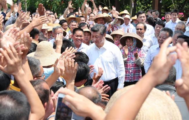 Chinese President Xi Jinping, also general secretary of the Communist Party of China Central Committee and chairman of the Central Military Commission, shakes hands with villagers in Shicha Village of Xiuying District in Haikou, south China's Hainan Province, April 13, 2018. Xi made an inspection tour in Hainan from Wednesday to Friday.[Photo: Xinhua]