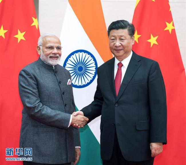 Chinese President Xi Jinping (R) meets with Indian Prime Minister Narendra Modi in Qingdao, east China's Shandong Province, June 9, 2018. [Photo: Xinhua]