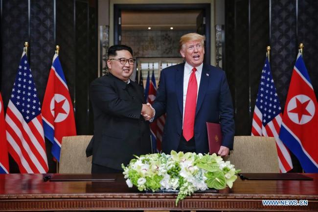 Top leader of the Democratic People's Republic of Korea (DPRK) Kim Jong Un (L) shakes hands with U.S. President Donald Trump during the signing ceremony of a joint statement in Singapore on June 12, 2018.[Photo: Xinhua]