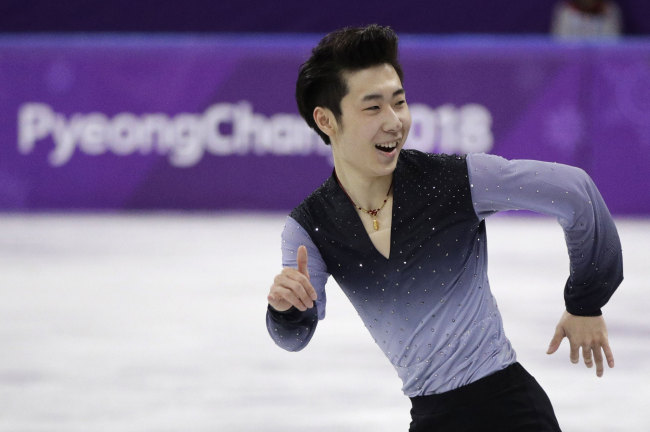 Jin Boyang of China performs during the men's free figure skating final in the Gangneung Ice Arena at the 2018 Winter Olympics in Gangneung, South Korea, Saturday, Feb. 17, 2018.[Photo:AP]