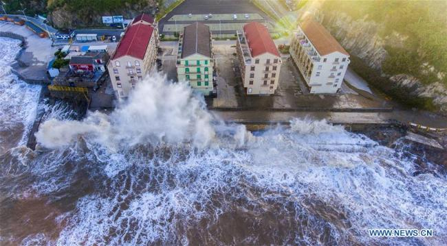 Aerial photo taken on July 10, 2018, shows huge waves beating against the sea shore in Shitang Township of Wenling City, east China's Zhejiang Province.