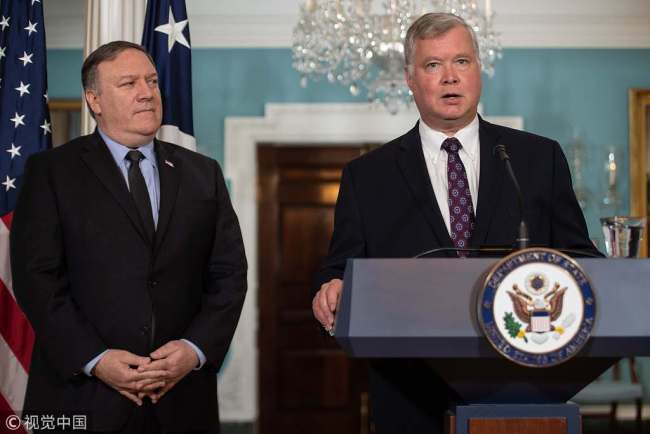 New US special representative to North Korea Steve Biegun speaks after being named by Secretary of State Mike Pompeo (L) at the State Department in Washington, DC, on August 23, 2018. [Photo: VCG]