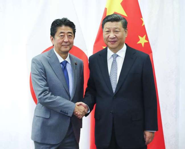Chinese President Xi Jinping and Japanese Prime Minister Shinzo Abe meet on Wednesday, September 12, 2018, on further improving bilateral ties and shouldering joint responsibility in promoting global and regional peace and stability, as well as development and prosperity.[Photo: Xinhua]