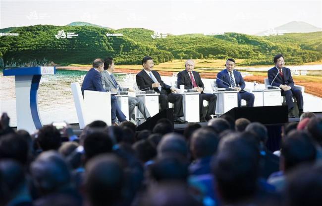 Chinese President Xi Jinping (3rd L, rear) attends the plenary session of the fourth Eastern Economic Forum (EEF), together with Russian President Vladimir Putin, Mongolian President Khaltmaa Battulga, Japanese Prime Minister Shinzo Abe and South Korean Prime Minister Lee Nak-yon, in Vladivostok in Russia's Far East, on Sept. 12, 2018. [Photo: Xinhua]