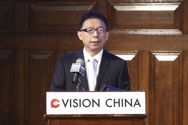 Editor-in-Chief of China Daily Zhou Shuchun addresses China Daily's Vision China event in London, Sept 13, 2018. [Photo by Zou Hong/chinadaily.com.cn]