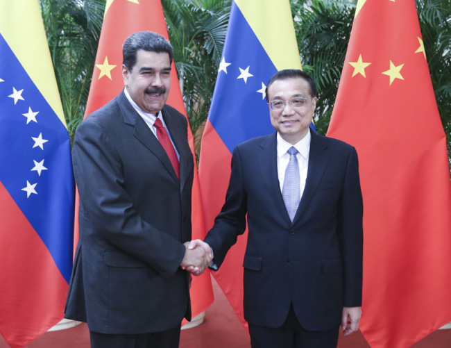 Chinese Premier Li Keqiang meets with visiting Venezuelan President Nicolas Maduro at the Great Hall of the People in Beijing on Friday, September 14, 2018.[Photo: gov.cn]