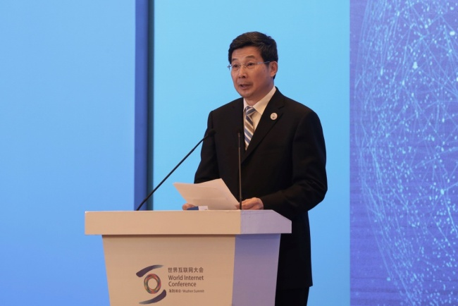 "Zhuang Rongwen, minister of Cyberspace Administration of China, delivers a speech at a ministerial forum themed ""Bridging the Digital Divide"" in Wuzhen, East China's Zhejiang province on Nov 8, which serves as a sub-forum of the fifth World Internet Conference. [Photo:Chinadaily]"
