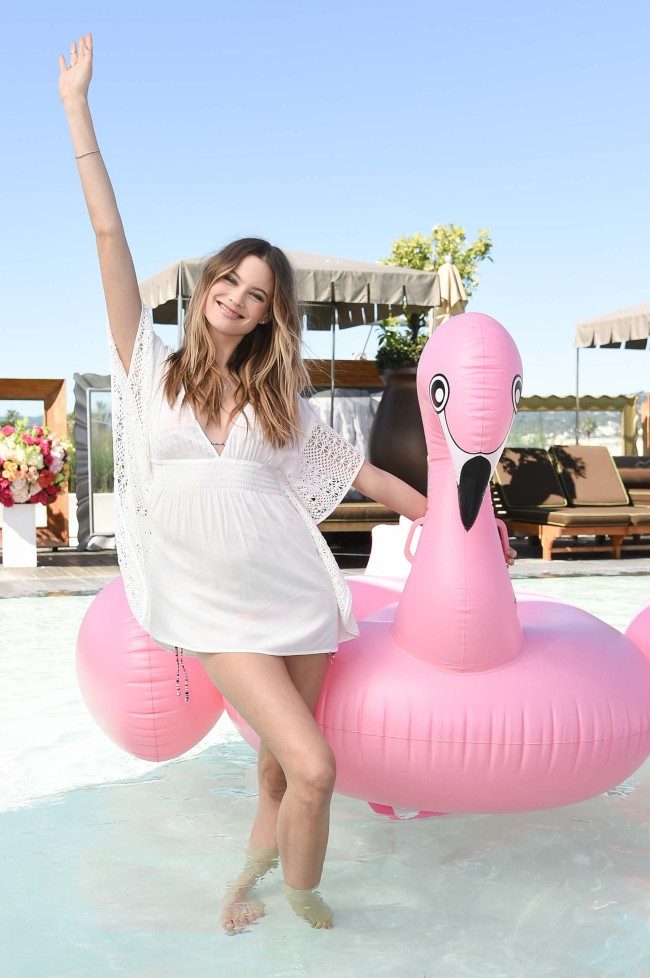 Behati Prinsloo poses for photos at the 2016 Victoria's Secret Swim Special Celebration held at the SLS Hotel on Tuesday, March 8, 2016, in Los Angeles. [Photo: AP]