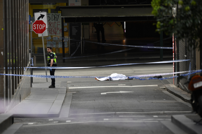 A deceased person is seen on Bourke street after an incident in Melbourne, Australia, 09 November 2018. [Photo: IC]