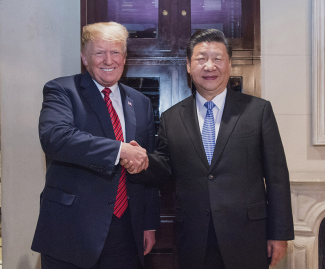 Chinese President Xi Jinping shakes hands with his U.S. counterpart Donald Trump on December 1, 2018, in in Buenos Aires, Argentina. [Photo: Xinhua]