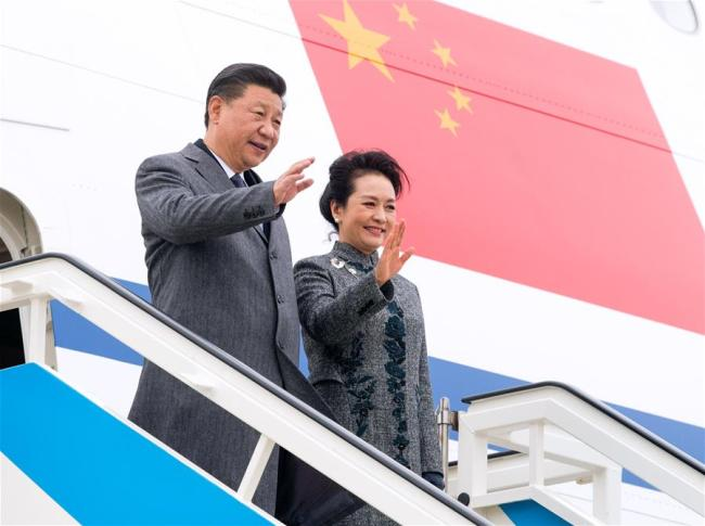 Chinese President Xi Jinping (L) and his wife Peng Liyuan disembark from the airplane after arriving in Lisbon, Portugal, on Dec. 4, 2018. Xi arrived in Portugal on Tuesday for a two-day state visit. [Photo: Xinhua/Li Xueren]