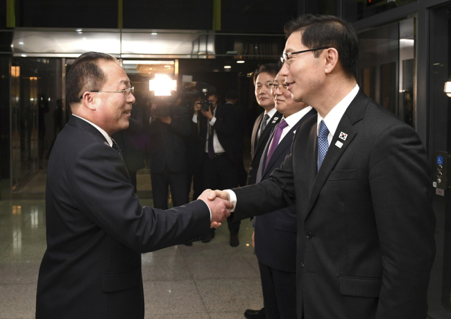 In this photo provided by South Korea Unification Ministry, South Korean Vice Unification Minister Chun Hae-sung, right, shakes hands with the head of North Korean delegation Jon Jong Su after a meeting at Panmunjom in the Demilitarized Zone in Paju, South Korea, Wednesday, Jan. 17, 2018. [File photo: South Korea Unification Ministry via AP]