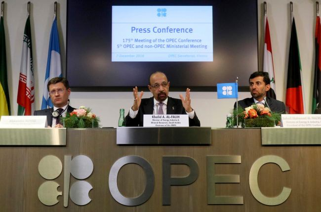 Russian Minister of Energy Alexander Novak, Khalid Al-Falih, Minister of Energy, Industry and Mineral Resources of Saudi Arabia and Minister of Energy of the United Arab Emirates, UAE, Suhail Mohamed Al Mazrouei, from left, attend a news conference after a meeting of the Organization of the Petroleum Exporting Countries, OPEC, and non OPEC members, at their headquarters in Vienna, Austria, Austria, Friday, Dec. 7, 2018. [Photo: AP /Ronald Zak]