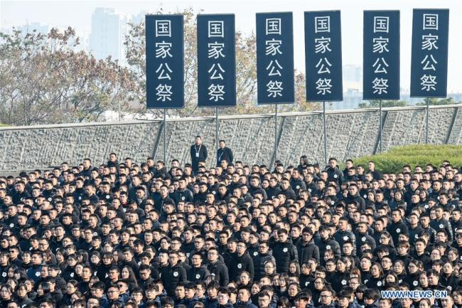 Photo taken on Dec. 13, 2018 shows the scene of the state memorial ceremony for China's National Memorial Day for Nanjing Massacre Victims at the memorial hall for the massacre victims in Nanjing, east China's Jiangsu Province. [Photo: Xinhua/Ji Chunpeng]