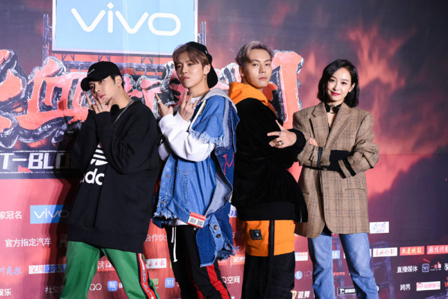 """(From left) Hong Kong singer and actor Jackson Wang of South Korean boy group GOT7, Chinese singer and actor Lu Han, Hong Kong singer and actor William Chan, Chinese singer and actress Victoria Song or Song Qian attend a press conference for the reality talent TV show """"Hot-Blood Dance Crew"""" in Shanghai, China. [Photo: IC]"""