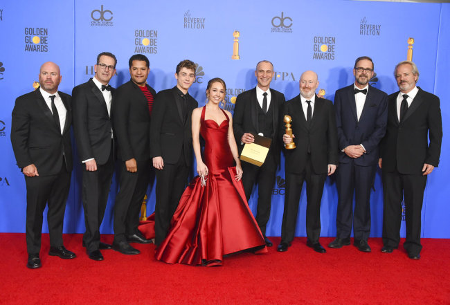 """The cast and crew of """"The Americans"""" pose in the press room with the award for best television series, drama at the 76th annual Golden Globe Awards at the Beverly Hilton Hotel on Sunday, Jan. 6, 2019, in Beverly Hills, Calif. [Photo: Invision/AP/Jordan Strauss]"""