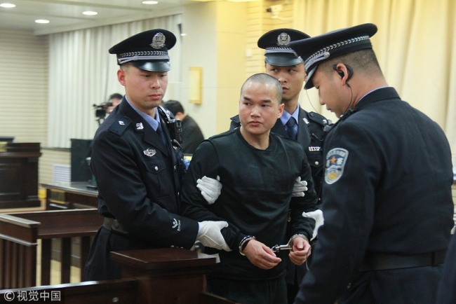Zhang Koukou stands trial at a court in Hanzhong, Shaanxi Province on January 8, 2019. [Photo: VCG]