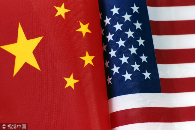 National flags of China and the U.S. [Photo: VCG]