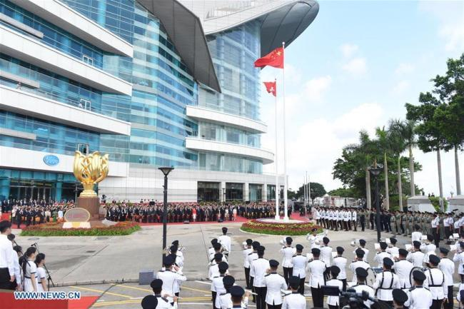 A flag-raising ceremony is held at Golden Bauhinia Square to celebrate the 21st anniversary of Hong Kong's return to the motherland, in Hong Kong, south China, July 1, 2018. [File photo: Xinhua]