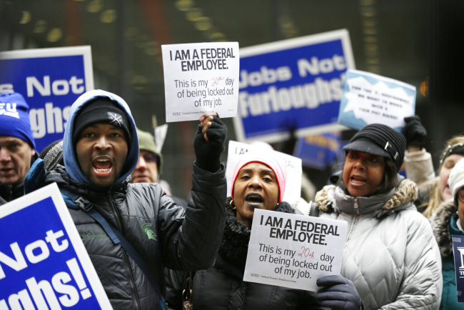 Government workers rally against the partial government shutdown at Federal Plaza, Thursday, Jan. 10, 2019, in Chicago. The partial government shutdown continues to drag on with hundreds of thousands of federal workers off the job or working without pay as the border wall fight persists. [Photo: AP]