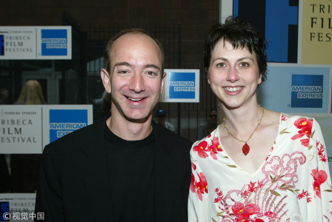 """Jeff Bezos and wife MacKenzie at the premiere of """"The Italian Job,"""" featured on the last day of the Tribeca Film Festival in New York on May 11, 2003. [File Photo: VCG]"""