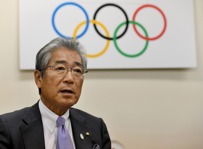This file photo taken on January 19, 2018 shows Japanese Olympic Committee president Tsunekazu Takeda speaking during an interview with AFP at his office in Tokyo. [File photo: AFP/Toshifumi Kitamura]