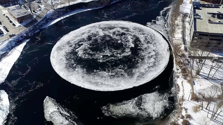 Giant rotating ice disk forms on river in Maine