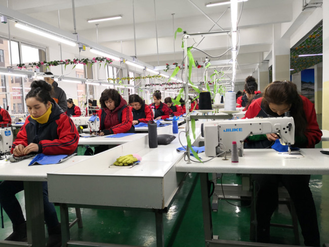 Students are practicing sewing. [Photo: China Plus]