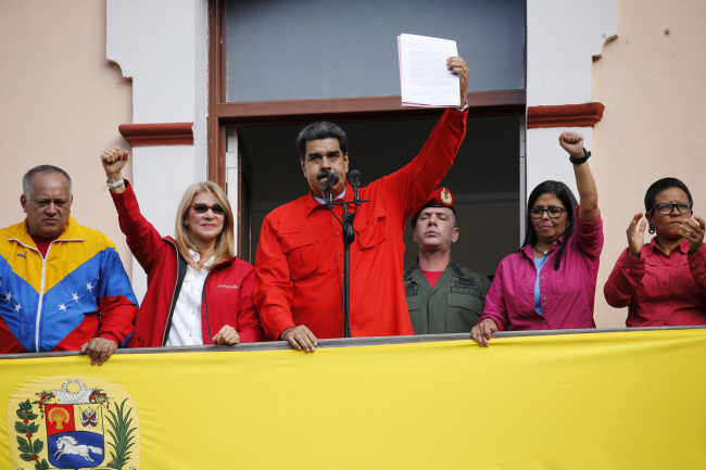 Venezuelan President Nicolas Maduro announces he is breaking relations with the U.S., to supporters from a balcony at Miraflores presidential palace in Caracas, Venezuela, Wednesday, Jan. 23, 2019. [Photo: AP]