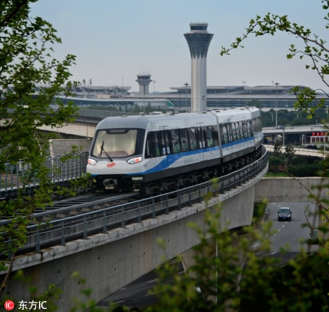 A maglev train runs on China's first medium-low speed maglev railway in May 2016 in Changsha. [File Photo: IC]