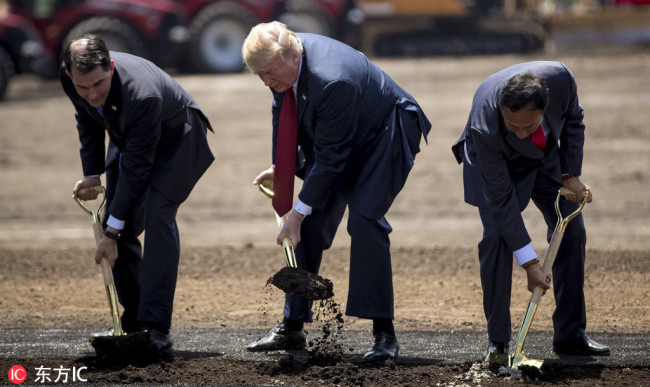 (Left to right) Wisconsin Gov. Scott Walker, President Donald Trump and Foxconn chairman Terry Gou at a groundbreaking for the Foxconn plant Thursday, June 28, 2018 in Mt. Pleasant, Wis. [Photo: IC]