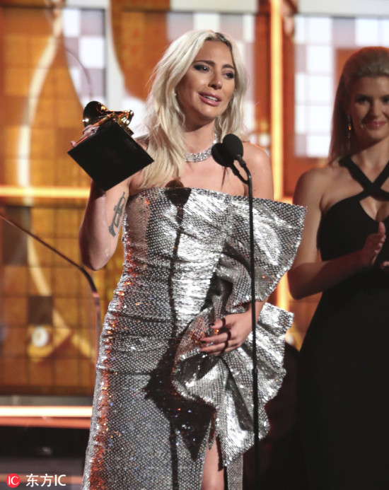"Lady Gaga accepts the award for best pop duo or group performance for ""Shallow"" at the 61st annual Grammy Awards on Sunday, Feb. 10, 2019, in Los Angeles. [Photo: AP]"