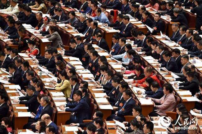 The second plenary meeting of the second session of the 13th National People's Congress (NPC) opens at the Great Hall of the People in Beijing on Friday, March 8, 2019. [Photo: people.cn]