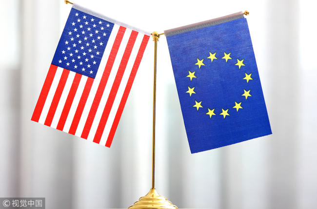 Flags of the United States and the European Union. [File photo: VCG]