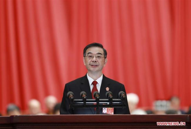 Chief Justice Zhou Qiang delivers a work report of the Supreme People's Court (SPC) at the third plenary meeting of the second session of the 13th National People's Congress (NPC) at the Great Hall of the People in Beijing, March 12, 2019. [Photo: Xinhua/Pang Xinglei]