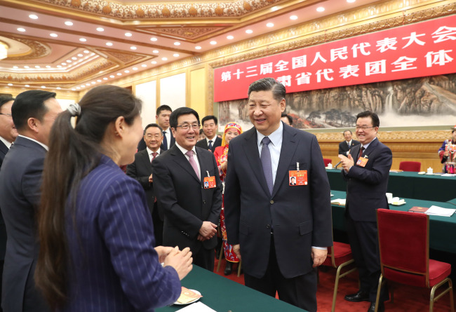 President Xi Jinping attends a panel discussion with his fellow deputies from Gansu Province at the second session of the 13th National People's Congress in Beijing on March 7, 2019. [Photo: Xinhua]
